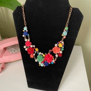 Brightly colored floral necklace.
